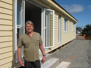 Little Greenie designer, Laurence outside the almost completed house in Otaki.